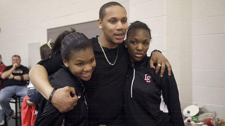 Sisters Ashli (left) and Aliyah Jeune each dedicated their 1,000th career point to older brother Anthony (center) -- The Star-Ledger