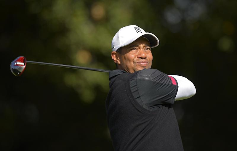 Woods keeps 2-shot lead on tough day at Sherwood