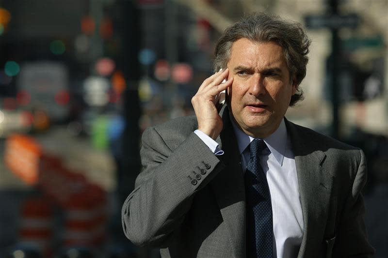 Former senior managing director at Evercore Group Hixon Jr. speaks on his phone as he arrives at the federal courthouse in New York