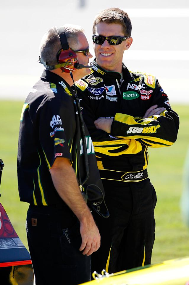 TALLADEGA, AL - OCTOBER 22: Carl Edwards (R), driver of the #99 Subway Ford, talks with crew chief Bob Osborne (L) during qualifying for the NASCAR Sprint Cup Series Good Sam Club 500 at Talladega Superspeedway on October 22, 2011 in Talladega, Alabama.  (Photo by Geoff Burke/Getty Images for NASCAR)