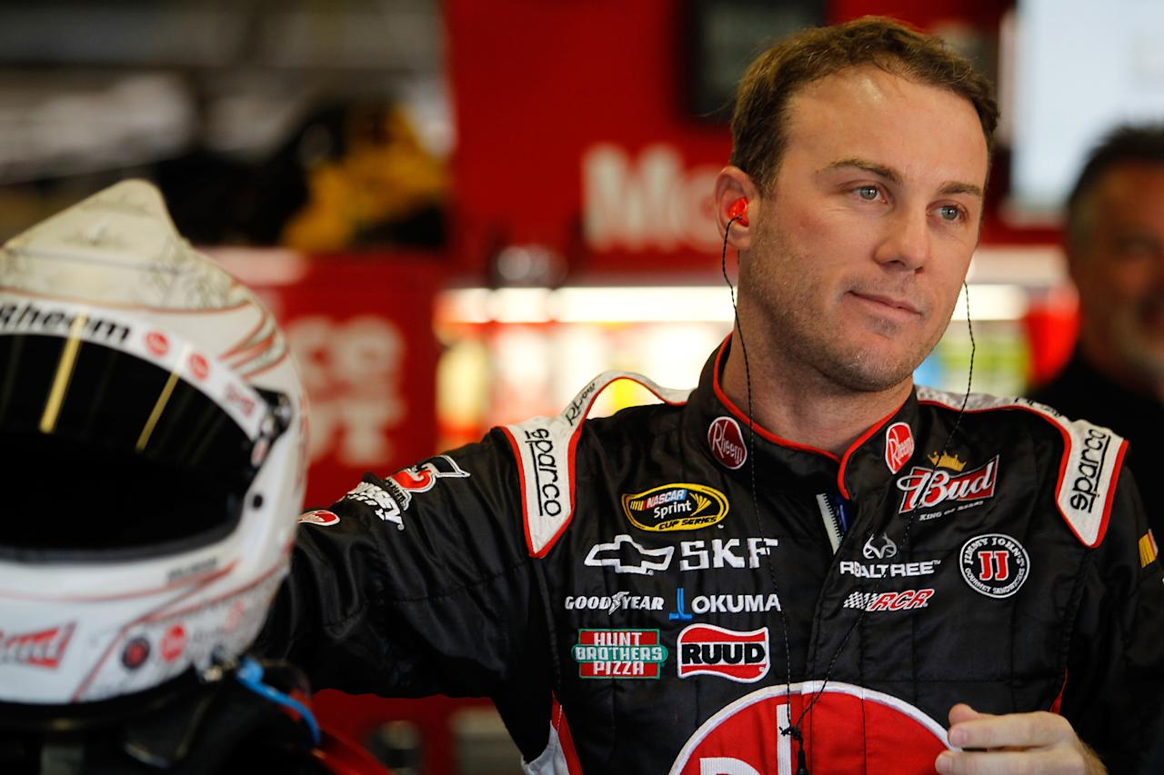 FORT WORTH, TX - NOVEMBER 05:  Kevin Harvick, driver of the #29 Rheem Chevrolet, stands in the garage during practice for the NASCAR Sprint Cup Series AAA Texas 500 at Texas Motor Speedway on November 5, 2011 in Fort Worth, Texas.  (Photo by Todd Warshaw/Getty Images for NASCAR)