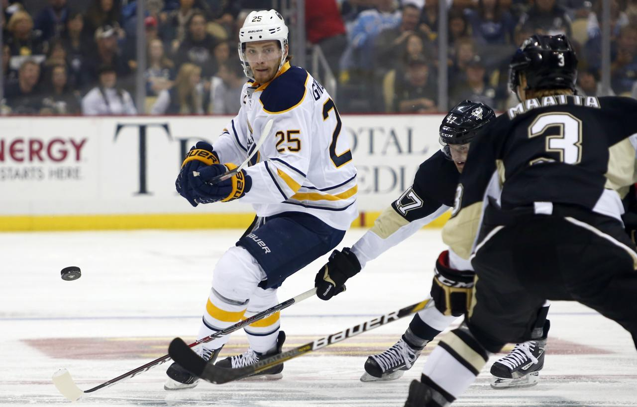 PITTSBURGH, PA - OCTOBER 05: Mikhail Grigorenko #25 of the Buffalo Sabres dumps the puck in against the Pittsburgh Penguins during the game at Consol Energy Center on October 5, 2013 in Pittsburgh, Pennsylvania. (Photo by Justin K. Aller/Getty Images)