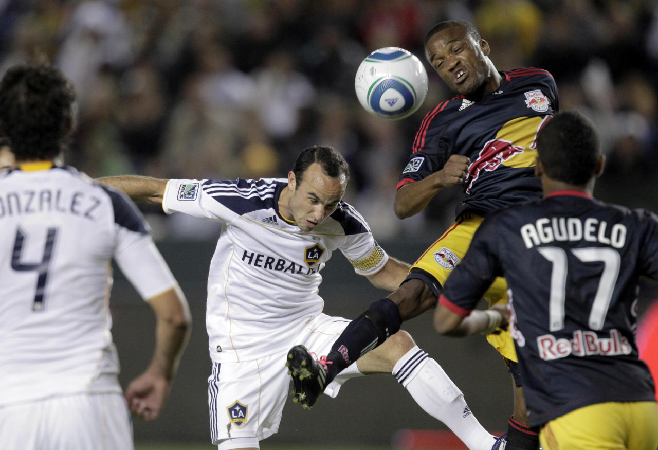 Los Angeles Galaxy forward Landon Donovan, center left, and New York Red Bulls midfielder Dane Richards head the ball during the second half of the second game of an MLS soccer Western Conference semifinal at Home Depot Center in Carson, Calif., Thursday, Nov. 3, 2011. The Galaxy won 2-1. (AP Photo/Jae Hong)