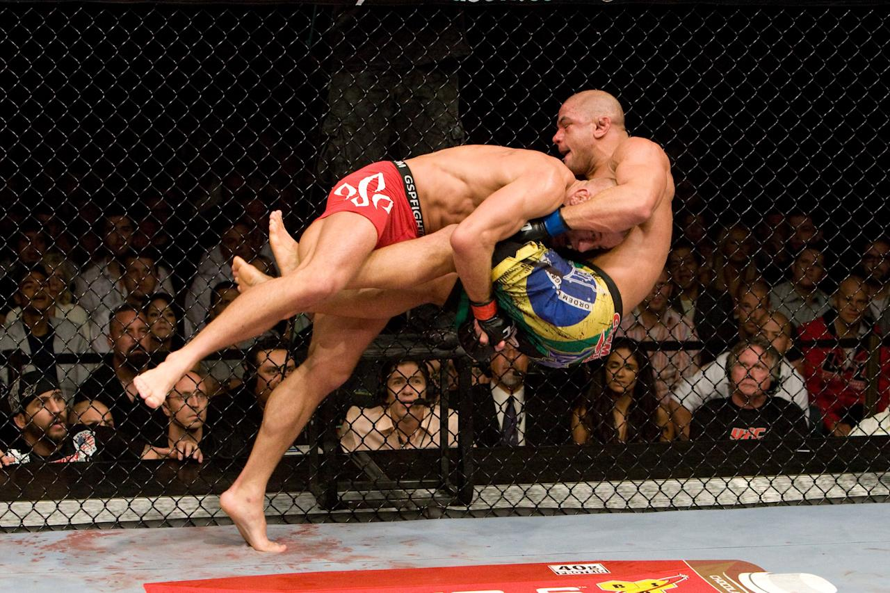 LAS VEGAS - JULY 11: Georges St-Pierre (red tight shorts) def. Thiago Alves (black Brazil flag shorts) - Unanimous Decision during UFC 100 at Mandalay Bay Events Center on July 11, 2009 in Las Vegas, Nevada. (Photo by Josh Hedges/Zuffa LLC via Getty Images)