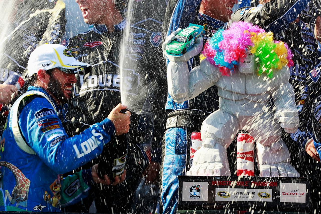 DOVER, DE - JUNE 03:  Jimmie Johnson, driver of the #48 Lowe's Madagascar Chevrolet, celebrates in Victory Lane after winning the NASCAR Sprint Cup Series FedEx 400 benefiting Autism Speaks at Dover International Speedway on June 3, 2012 in Dover, Delaware.  (Photo by Geoff Burke/Getty Images)