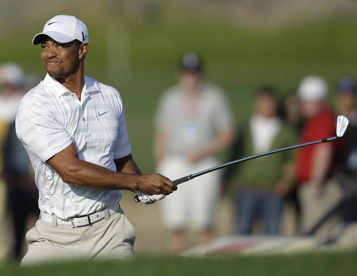 Tiger Woods from U.S. reacts on the 17th hole during the second round of Abu Dhabi HSBC Championship, Friday, Jan. 27, 2012 in Abu Dhabi, United Arab Emirates. (AP Photo/Kamran Jebreili)