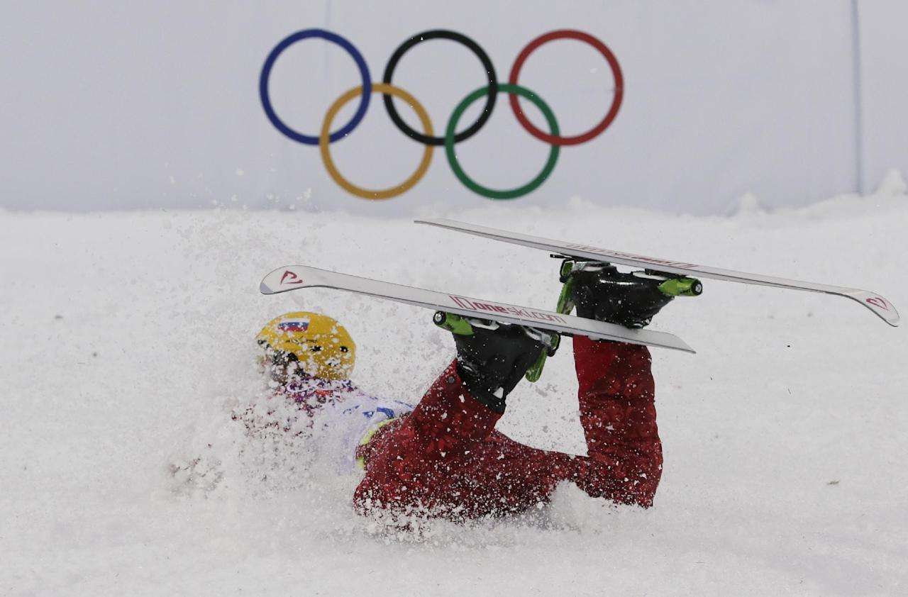 Russia's Ilya Burov crashes after landing during men's freestyle skiing aerials qualifying at the Rosa Khutor Extreme Park, at the 2014 Winter Olympics, Monday, Feb. 17, 2014, in Krasnaya Polyana, Russia. (AP Photo/Andy Wong)