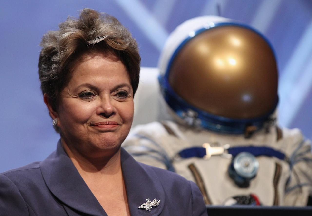 HANOVER, GERMANY - MARCH 05:  Brazilian President Dilma Rouseff smiles next to an astronaut's suit at the opening ceremony of the CeBIT 2012 technology trade fair on March 5, 2012 in Hanover, Germany. CeBIT 2012, the world's largest information technology trade fair, will run from March 6-10, and advances in cloud computing and security are major features this year.  (Photo by Sean Gallup/Getty Images)