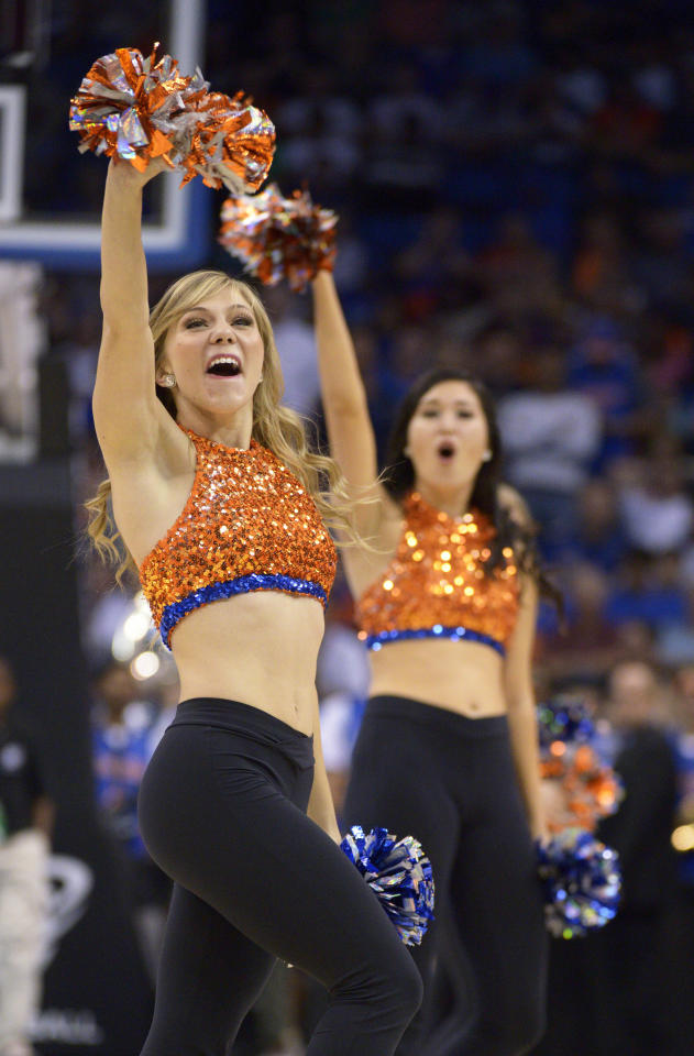 Florida cheerleaders perform during the first half in a third-round game at the NCAA college basketball tournament against Pittsburgh, Saturday, March 22, 2014, in Orlando, Fla. (AP Photo/Phelan M. Ebenhack)
