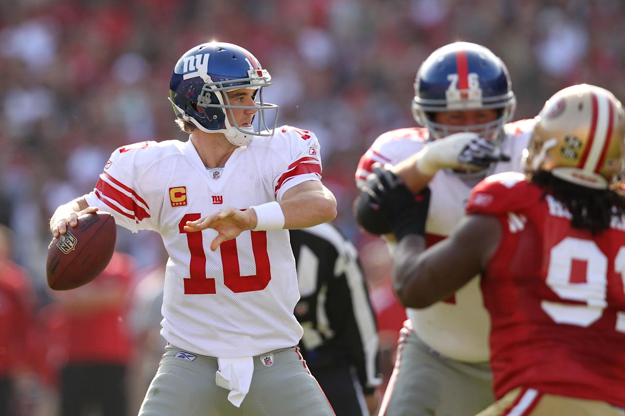 SAN FRANCISCO, CA - NOVEMBER 13:  Eli Manning #10 of the New York Giants drops back to pass against the San Francisco 49ers at Candlestick Park on November 13, 2011 in San Francisco, California.  (Photo by Ezra Shaw/Getty Images)