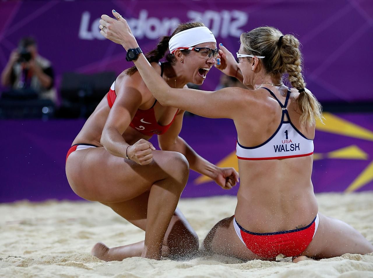Kerri Walsh Jennings (R) and Misty May-Treanor of the United States celebrate winning the Gold medal in the Women's Beach Volleyball Gold medal match against the United States on Day 12 of the London 2012 Olympic Games at the Horse Guard's Parade on August 8, 2012 in London, England.  (Photo by Jamie Squire/Getty Images)