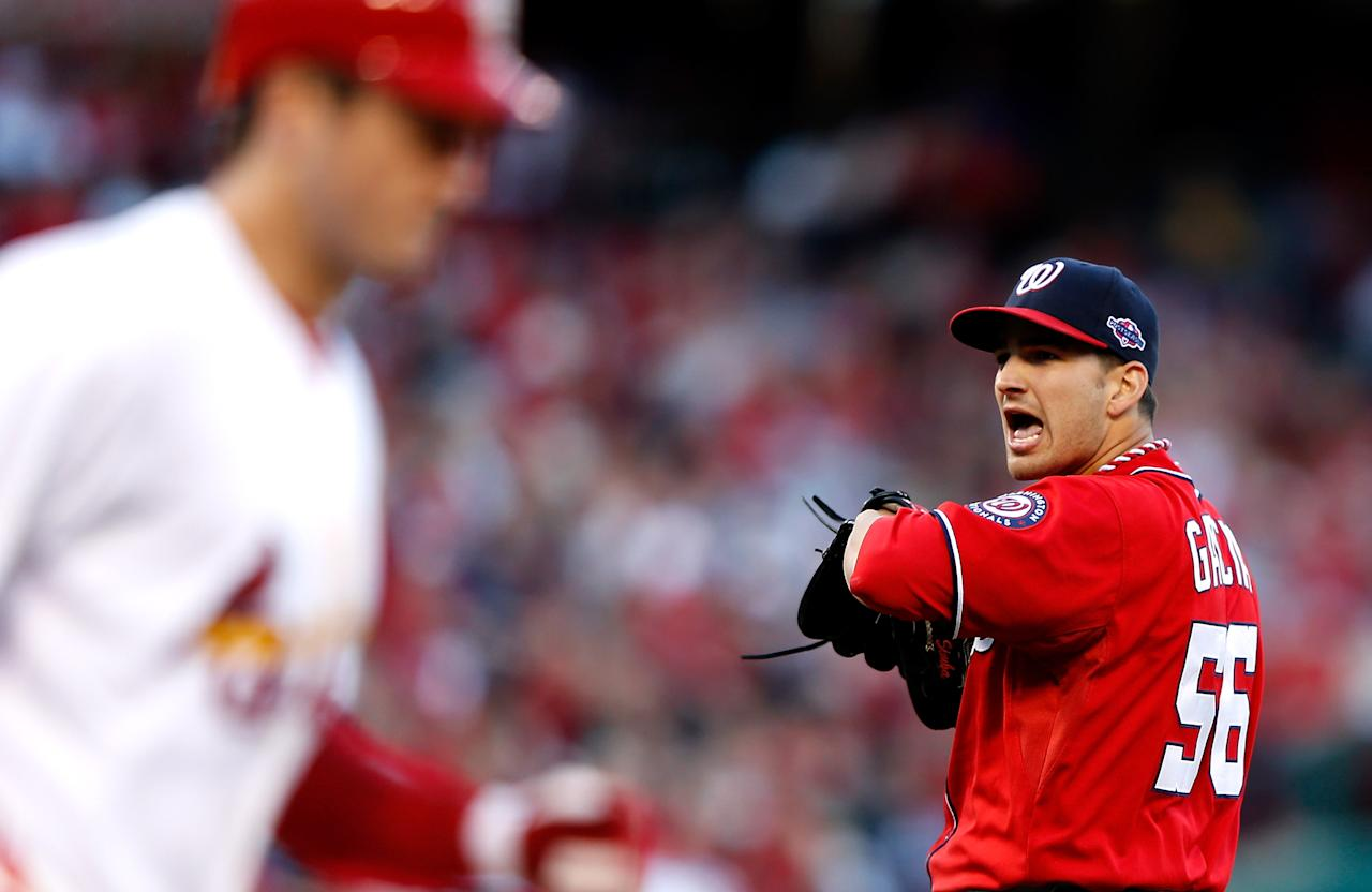 ST LOUIS, MO - OCTOBER 08:  Christian Garcia #56 of the Washington Nationals reacts after walking David Freese #23 of the St. Louis Cardinals in the fifth inning during Game Two of the National League Division Series at Busch Stadium on October 8, 2012 in St Louis, Missouri.  (Photo by Jamie Squire/Getty Images)