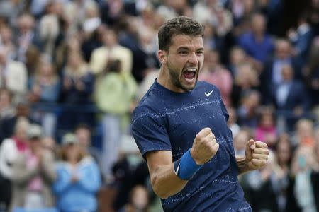 Bulgaria's Dimitrov celebrates after defeating Spain's Lopez in their men's singles final tennis match at the Queen's Club Championships in west London
