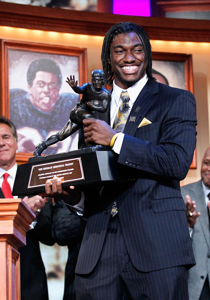 NEW YORK, NY - DECEMBER 10:  (EDITORIAL USE ONLY THROUGH DECEMBER 15, 2011, NO ARCHIVE, NO SALES) In this handout provided by the Heisman Trophy Trust. Robert Griffin III of the Baylor Bears poses with the trophy after being named the 77th Heisman Memorial Trophy Award winner at the Best Buy Theater on December 10, 2011 in New York City.  (Photo by Kelly Kline/Heisman Trophy Trust via Getty Images)