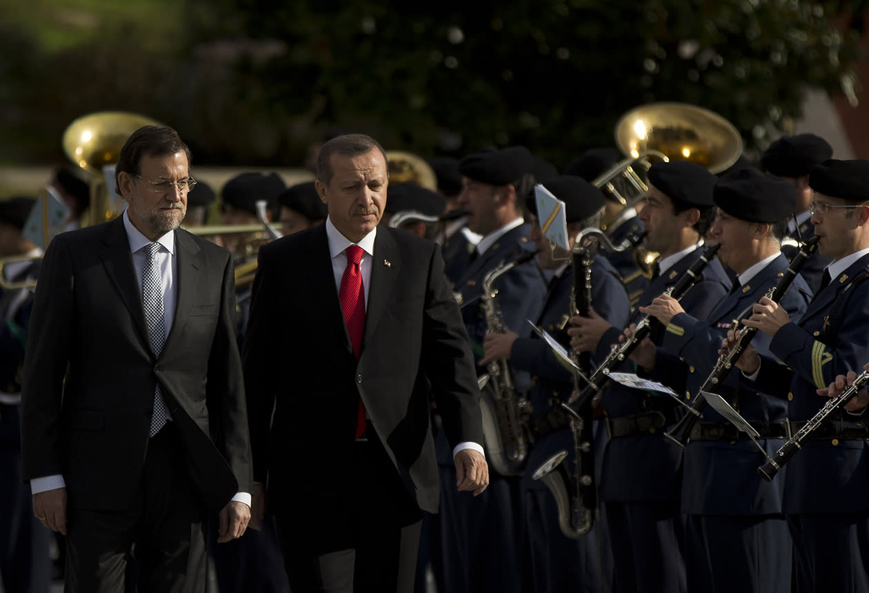 Spain's Prime Minister Mariano Rajoy, left, and Turkish Prime Minister Recep Tayyip Erdogan review troops during a welcome ceremony before a meeting at the Moncloa Palace, in Madrid.