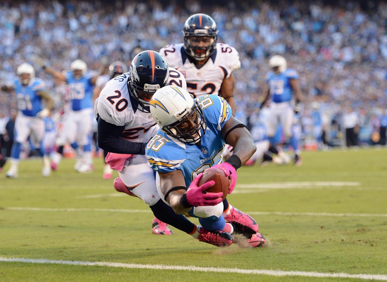 SAN DIEGO, CA - OCTOBER 15:  Antonio Gates #85 of the San Diego Chargers dives into the endzone for a touchdown in the first quarter past  Mike Adams #20 of the Denver Broncos during the NFL game at Qualcomm Stadium on October 15, 2012 in San Diego, California.  (Photo by Harry How/Getty Images)