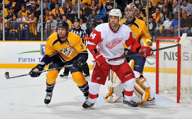 NASHVILLE, TN - APRIL 13:  Shea Weber #6 of the Nashville Predators and Todd Bertuzzi #44 of the Detroit Red Wings hold their positions in front of goalie Pekka Rinne #35 in Game Two of the Western Conference Quarterfinals during the 2012 NHL Stanley Cup Playoffs at the Bridgestone Arena on April 13, 2012 in Nashville, Tennessee.  (Photo by Frederick Breedon/Getty Images)