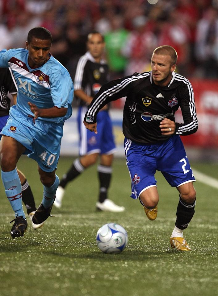 TORONTO - JULY 24: Midfielder #23 David Beckham of L.A. Galaxy brings the ball up field against defender #40 Freddie Sears of West Ham United during the 2008 Pepsi MLS All Star Game between the MLS All Stars and West Ham United at BMO Field on July 24, 2008 in Toronto, Canada. (Photo by Jonathan Daniel/Getty Images)