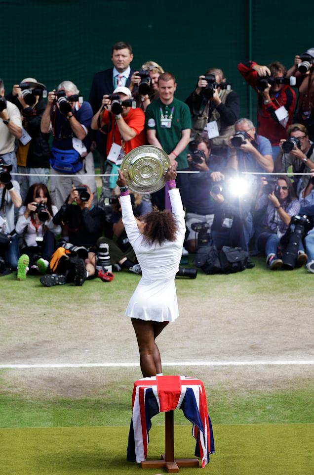 LONDON, ENGLAND - JULY 07:  Serena Williams of the USA lifts the winners trophy and celebrates after her Ladies? Singles final match against Agnieszka Radwanska of Poland on day twelve of the Wimbledon Lawn Tennis Championships at the All England Lawn Tennis and Croquet Club on July 7, 2012 in London, England.  (Photo by Anja Niedringhaus/Pool/Getty Images)