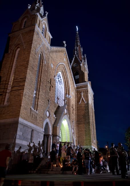 People gather in front of the St-Agnes church during a vigil for the victims of the train crash Lac-Megantic, Que., Friday, July 12, 2013. THE CANADIAN PRESS/Jacques Boissinot