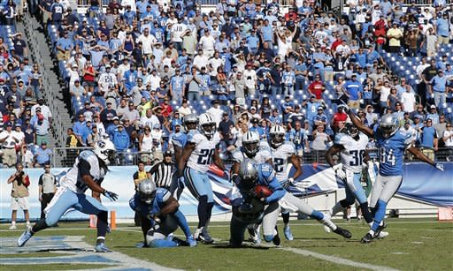 Titans get 1st win, beating Lions 44-41 in OT