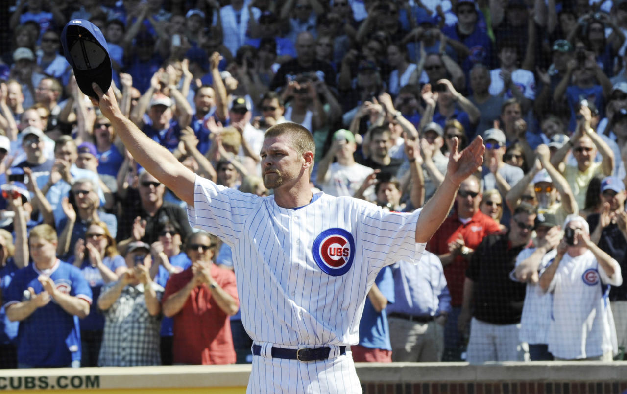 CHICAGO, IL - MAY 18: Kerry Wood #34 of the Chicago Cubs waves to fans after leaving the game against the Chicago White Sox  on May 18 2012 at Wrigley Field in Chicago, Illinois. inning. It was announced that Kerry Wood is retiring from baseball today.  (Photo by David Banks/Getty Images)