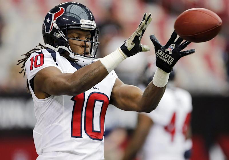 "Houston Texans wide receiver DeAndre Hopkins makes as catch, while wearing camouflage gloves prior to an NFL football game against the Arizona Cardinals, Sunday, Nov. 10, 2013, in Glendale, Ariz. The NFL is celebrating Veterans Day with their league wide ""Salute to Service"" campaign"