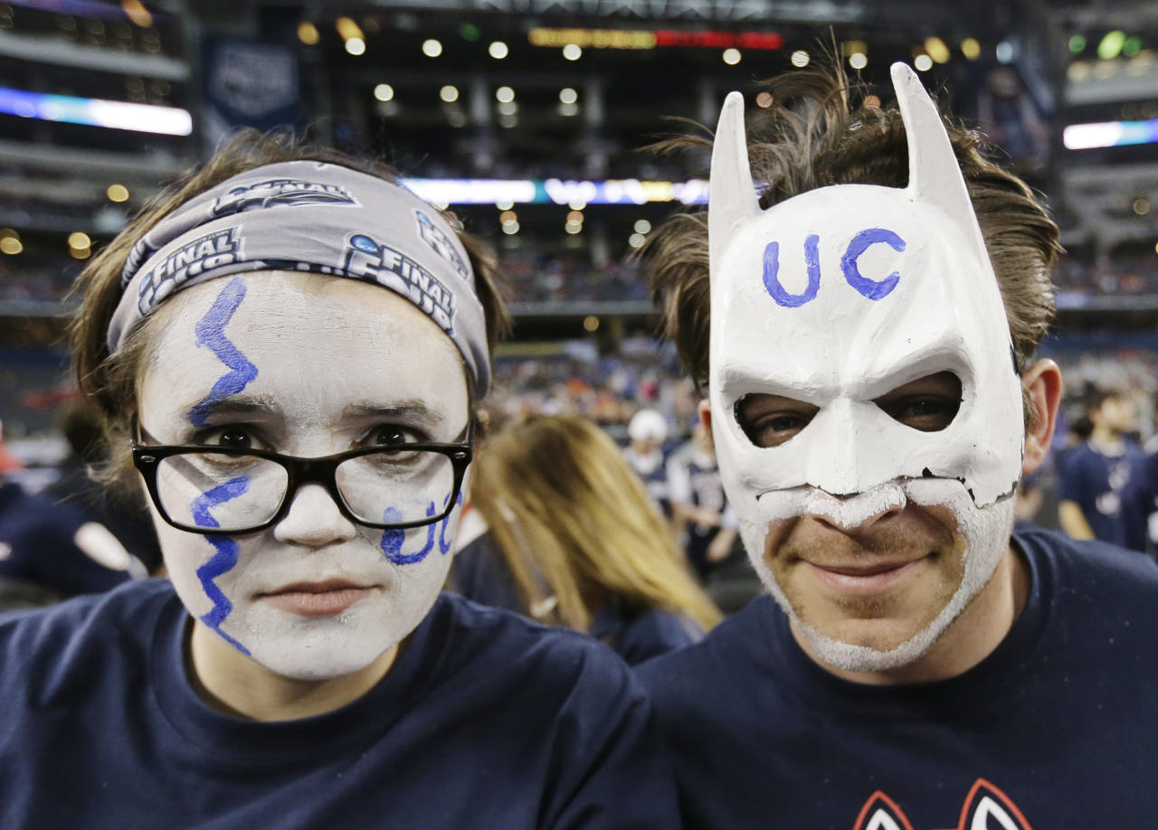 Connecticut fans show their support befer an NCAA Final Four tournament college basketball semifinal game against Florida Saturday, April 5, 2014, in Dallas. (AP Photo/Eric Gay)