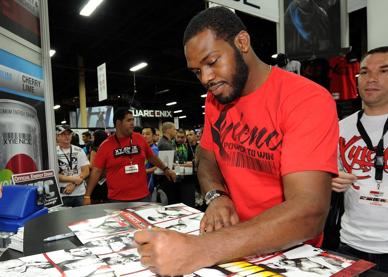 LAS VEGAS, NV - JULY 6:   UFC light heavyweight champion Jon Jones signs autographs during the UFC Fan Expo at the Mandalay Bay Convention Center on July 6, 2012 in Las Vegas, Nevada.  (Photo by Al Powers/Zuffa LLC/Zuffa LLC via Getty Images)
