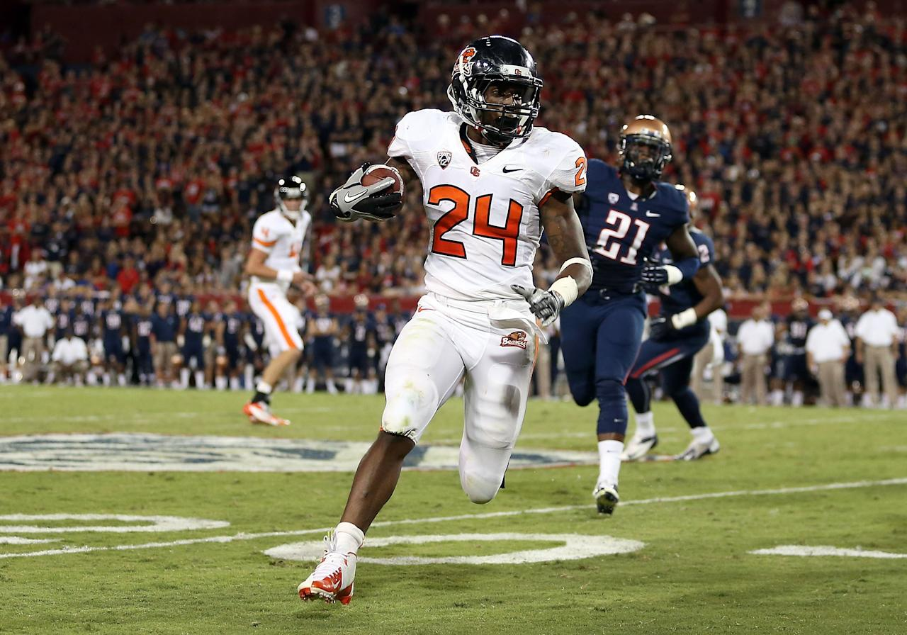 TUCSON, AZ - SEPTEMBER 29:  Running back Storm Woods #24 of the Oregon State Beavers rushes the football against the Arizona Wildcats during the college football game at Arizona Stadium on September 29, 2012 in Tucson, Arizona.  (Photo by Christian Petersen/Getty Images)