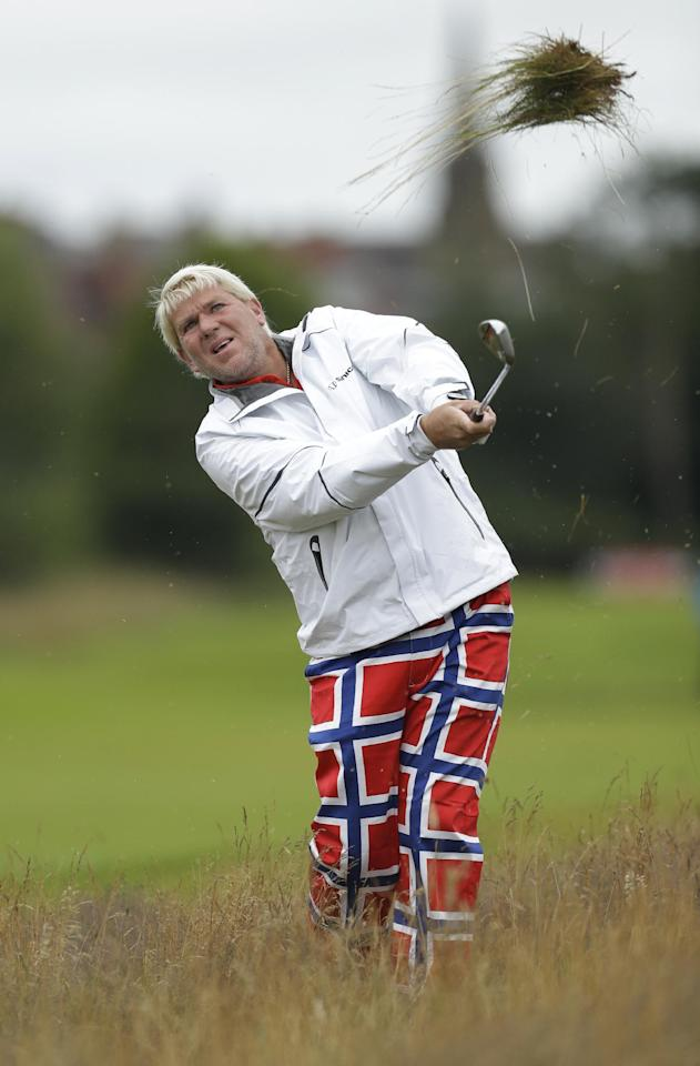 John Daly of the United States plays out of the rough on the second hole at Royal Lytham & St Annes golf club during the first round of the British Open Golf Championship, Lytham St Annes, England, Thursday, July 19, 2012. (AP Photo/Jon Super)
