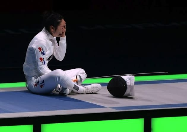 South Korean fencer Shin A Lam waits out the Korean protest of her loss — AFP