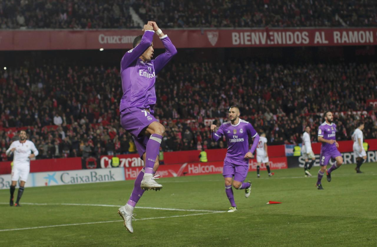 Football Soccer - Sevilla v Real Madrid - Spanish La Liga Santander - Ramon Sanchez Pizjuan stadium, Seville, Spain - 15/01/17 Real Madrid's Cristiano Ronaldo celebrates after scoring from penalty spot. REUTERS/Jon Nazca