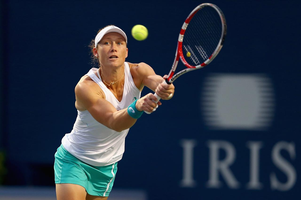 TORONTO, ON - AUGUST 08: Samantha Stosur of Australia hits a return in her 3-6, 3-6 loss to Petra Kvitova of the Czech Republic on day four of the Rogers Cup Toronto at Rexall Centre at York University on August 8, 2013 in Toronto, Ontario, Canada. (Photo by Andy Lyons/Getty Images)