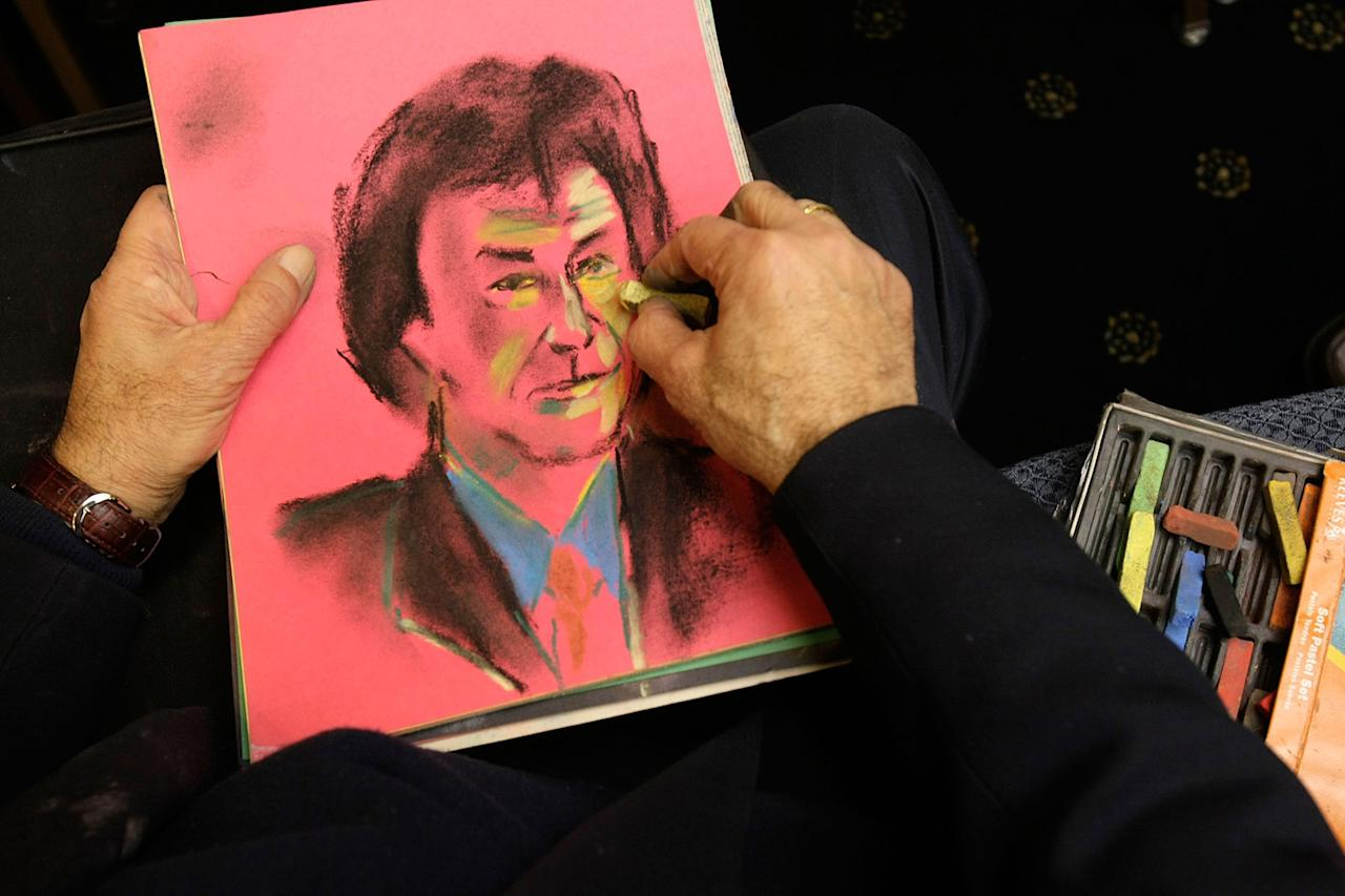 WASHINGTON - JANUARY 24:  An illustrator draws a portrait of Imran Khan, Chairman of Pakistan Tehreek-e-Insaf, aka Movement for Justice, during a briefing to the media at the National Press Club January 24, 2008 in Washington, DC. The briefing was focused on the current state of Pakistan.  (Photo by Alex Wong/Getty Images)