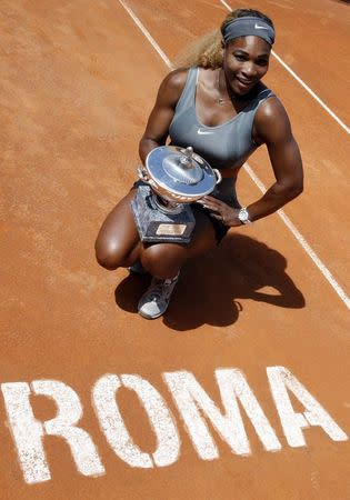 Williams of U.S. poses with trophy after winning the women's singles final match against Errani of Italy at the Rome Masters tennis tournament