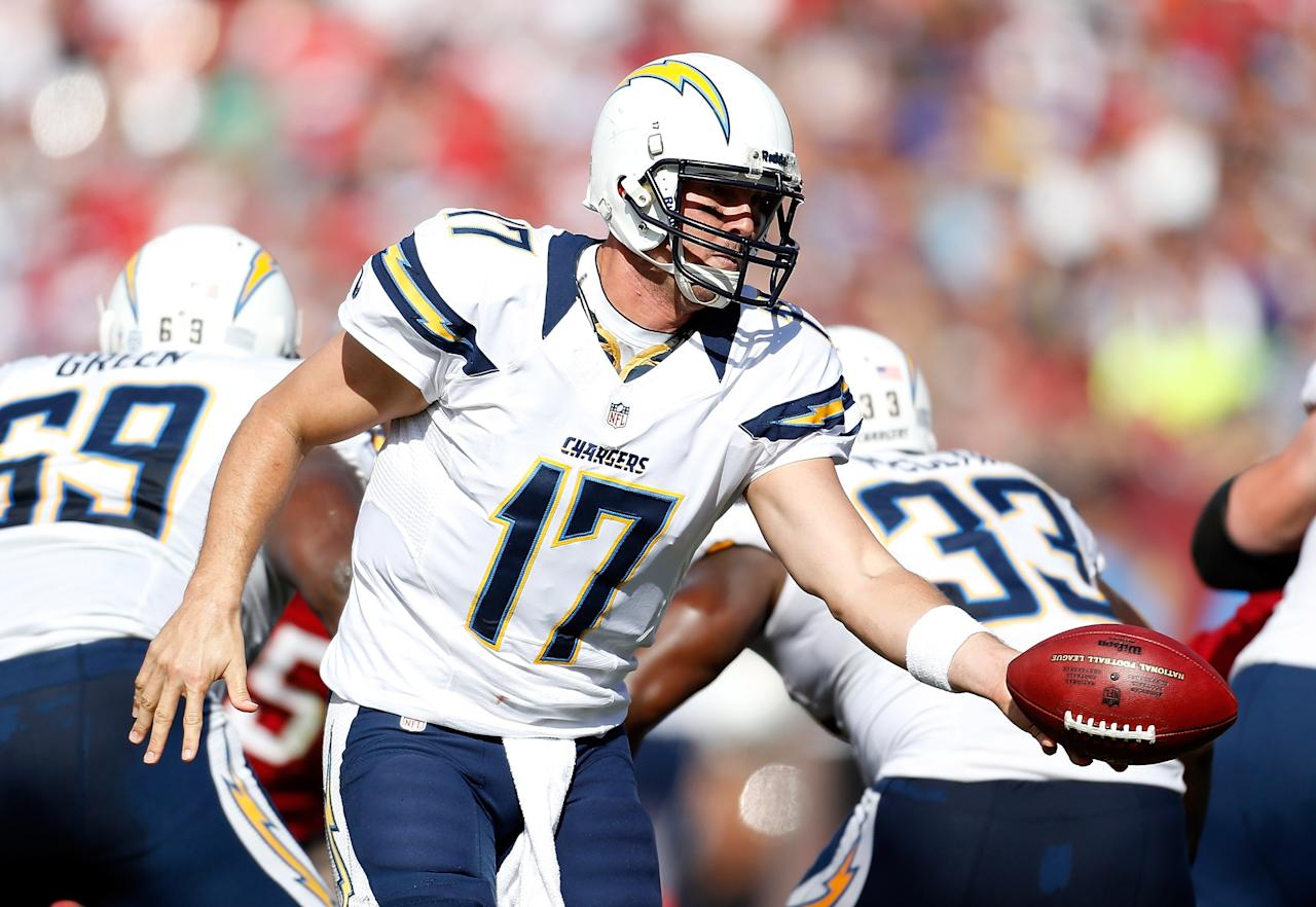 TAMPA, FL - NOVEMBER 11:  Quarterback Philip Rivers #17 of the San Diego Chargers hands the ball off against the Tampa Bay Buccaneers during the game at Raymond James Stadium on November 11, 2012 in Tampa, Florida.  (Photo by J. Meric/Getty Images)