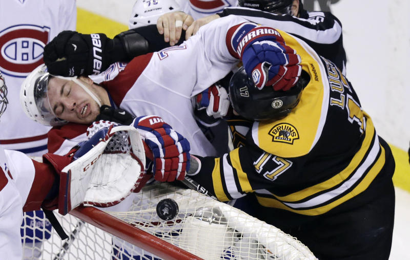 Boston Bruins left wing Milan Lucic, right, tangles with Montreal Canadiens right wing Brendan Gallagher (11) during the third period of Game 2 in the second-round of the Stanley Cup hockey playoff series in Boston, Saturday, May 3, 2014. The Bruins defeated the Canadiens 5-3, tying the best-of-seven games series at one game each