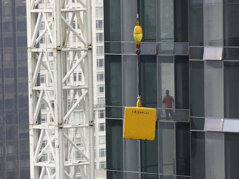 Concrete weight dangles from crane over NYC street