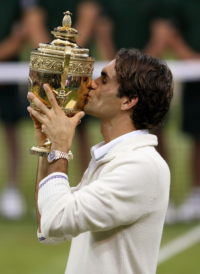 LONDON, ENGLAND - JULY 08:  Roger Federer of Switzerland kisses the winner's trophy after winning his Gentlemen's Singles final match against Andy Murray of Great Britain on day thirteen of the Wimbledon Lawn Tennis Championships at the All England Lawn Tennis and Croquet Club on July 8, 2012 in London, England.  (Photo by Julian Finney/Getty Images)