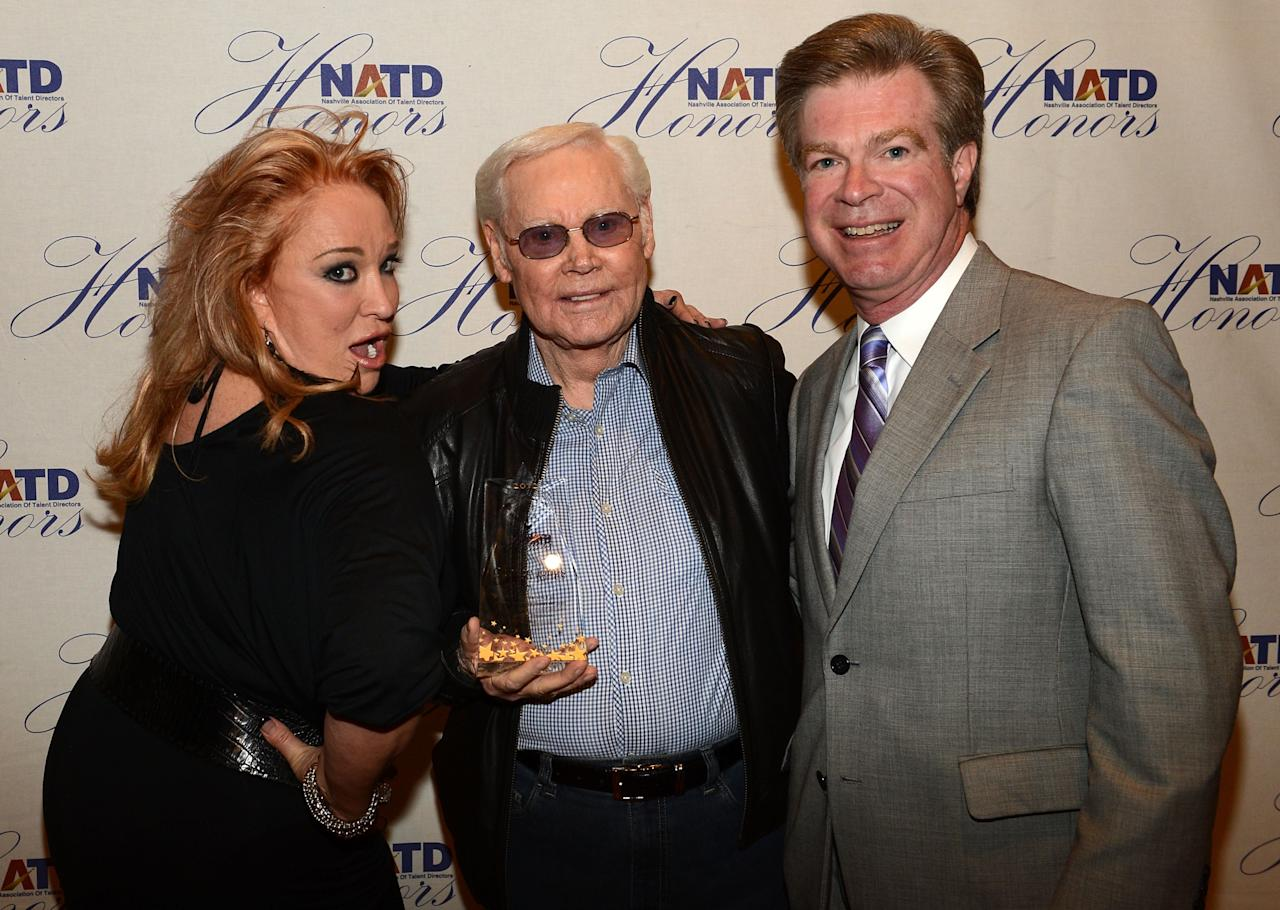 NASHVILLE, TN - NOVEMBER 14:  Recording Artist Tanya Tucker presents Singer/Songwriter George Jones his NATD Award along with NATD President Steve Tolman during the 2012 NATD Honors at The Hermitage Hotel on November 14, 2012 in Nashville, Tennessee.  (Photo by Rick Diamond/Getty Images for Nashville Association of Talent Directors)