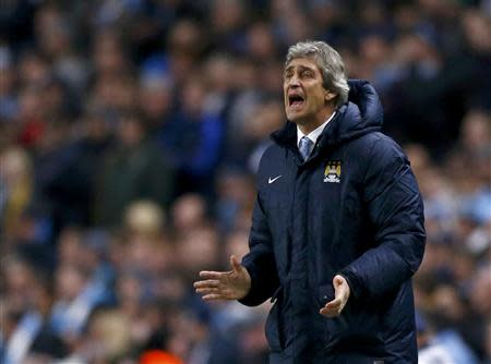 Manchester City's manager Manuel Pellegrini reacts during their Champions League round of 16 first leg soccer match against Barcelona at the Etihad Stadium in Manchester