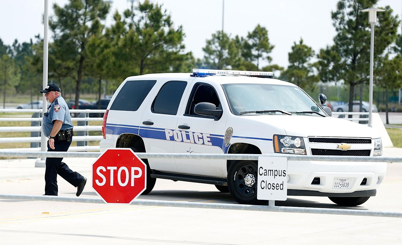 CYPRESS, TX - APRIL 09:  Campus police seal off the campus after at least 14 people were injured in a stabbing incident at the Cy-Fair campus of Lone Star College on April 9, 2013 in Cypress, Texas. The community college located in northwest Houston was on lockdown until police detained a 21-year-old male student believed to be a suspect.  (Photo by Scott Halleran/Getty Images)