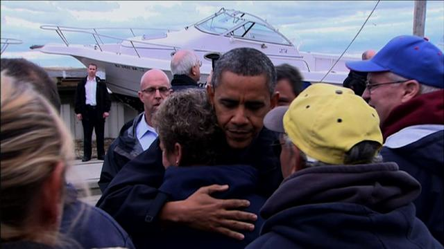 Obama vows to stand with superstorm Sandy victims