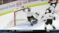 Bryan Bickell puts floating puck past Hiller