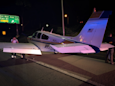 Light aircraft flies through underpass to make emergency landing on US motorway