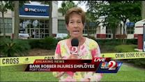 Bank employee hit on head during robbery