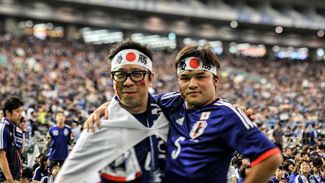 Japan fans clean up after themselves