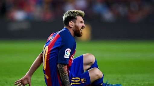 Barcelona loses Lionel Messi to groin strain in 1-1 draw with Atletico Madrid