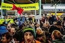 Dutch police arrest climate protesters at Schiphol